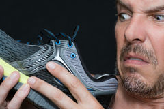 Man Disgusted By Shoes Smell royalty free stock image