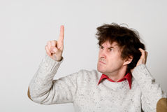 Man with disheveled hair pointing Royalty Free Stock Photography