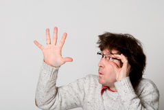 Man with disheveled hair pointing  hand at something interesting Royalty Free Stock Photos