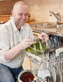 Man and dishwasher Stock Photo