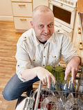 Man and dishwasher Royalty Free Stock Image