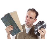 The man and disk for the tool .Portrait on a white background Stock Photography