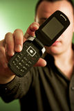 Man displaying cell phone. Young male displaying cell phone; face is partially obscured Stock Photos