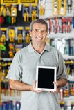 Man Displaying Digital Tablet In Hardware Store Stock Photography