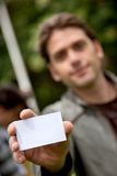 Man displaying his card Stock Photo