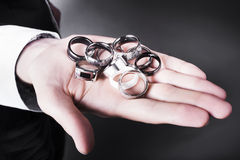 Man displaying a selection of stylish rings Royalty Free Stock Photo
