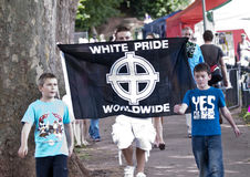 A man displaying a White Pride World-Wide flag Royalty Free Stock Photos