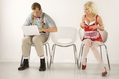 Man beside distracting woman. Stock Images