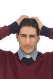 Man in distress. A man putting his hands on his head in distress with a worried look on his face Royalty Free Stock Photos