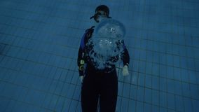 Man diver in scuba mask blowing underwater bubbles at training in diving lesson. Man diver in scuba mask blowing underwater bubbles during training in diving stock footage