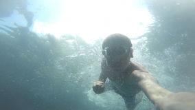 Man dives in the pool stock footage