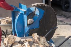 Production of firewood with a saw royalty free stock photography