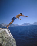 Man diving into Crater Lake. In Oregon Stock Image