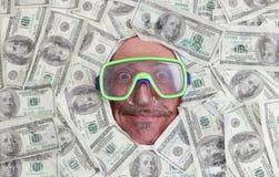 Man diving in dollar notes Royalty Free Stock Photos