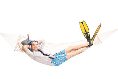 Man with diving equipment lying in a hammock Royalty Free Stock Images