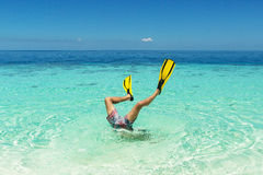 A man is diving in a flipper. Diver jump to the whater with flippers on his legs Royalty Free Stock Photo
