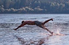 Man diving into lake Stock Photos