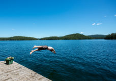 Man diving into a lake in the summer Royalty Free Stock Photo