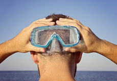 A man in a diving mask stands behind Stock Photos