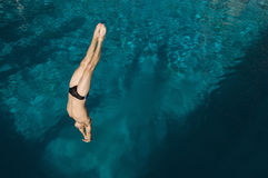 Man Diving Into The Pool. High angle view of a men diving into the pool Stock Photo