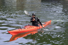 Man in a diving suit on the kayak Stock Images