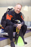Man in a diving suit Stock Image