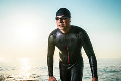 Man in diving suit on seashore Stock Photography