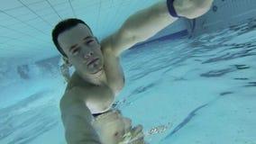 Man diving underwater stock footage