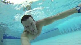 Man diving underwater stock video footage