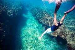 Man diving. Underwater photo of a young man diving Royalty Free Stock Image