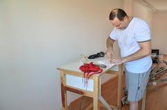 Man-diy renewing his living room Stock Photo