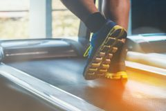A man do exercise in fitness center with happy Royalty Free Stock Photos