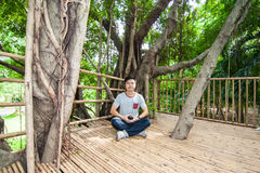 The man do meditation on the tree house Royalty Free Stock Photography