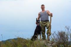 Man with doberman. Military man with a doberman stock photos