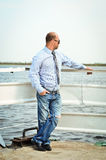 Man on the dock. Man in shirt standing near the water Stock Photography