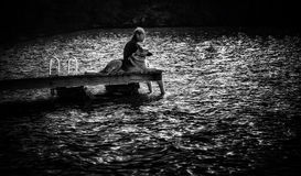 Man on Dock with Dog Royalty Free Stock Images