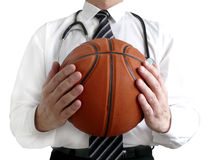 Man doctor with basketball ball Royalty Free Stock Image