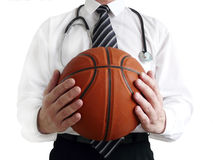 Man doctor with basketball ball in hands Stock Photography