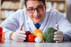 The man doctor checking the fruits and vegetables Stock Photo