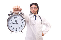 Man doctor with clock isolated Stock Photos