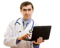 A man doctor consultant with a laptop Royalty Free Stock Photography