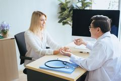 Man doctor examining to woman patient,Infertility counseling and suggestion using new technology,Physician giving a consultation a. Men doctor examining to women royalty free stock photos
