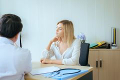 Man doctor examining to women patient,Infertility counseling and suggestion at room hospital. Men doctor examining to women patient,Infertility counseling and royalty free stock image