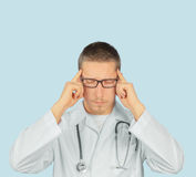 Man doctor with headache Royalty Free Stock Photography