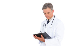 Man doctor holding clipboard Stock Photography