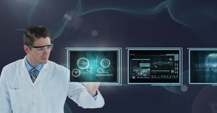 Man doctor interacting with medical interfaces against purple background. Digital composite of Man doctor interacting with medical interfaces against purple Stock Images