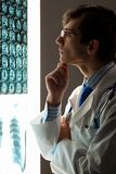 Man doctor looking at x-ray Royalty Free Stock Photography
