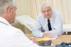 Man in doctor's office Royalty Free Stock Images