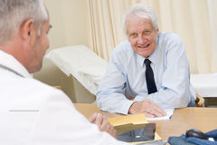 Man in doctor's office Royalty Free Stock Photos