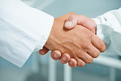 Man doctor shakes hand Royalty Free Stock Photo